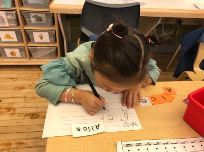 Alice in K/1-14 is working hard studying words, and names.