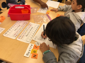 Naz in K/1-14 is working hard studying words, and names.