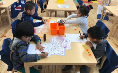 Kids in K/1-14 are working hard studying words, and names.