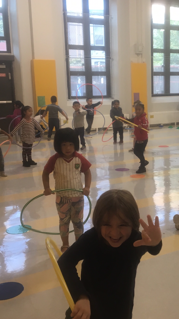 Kids with hula hoops in the gym