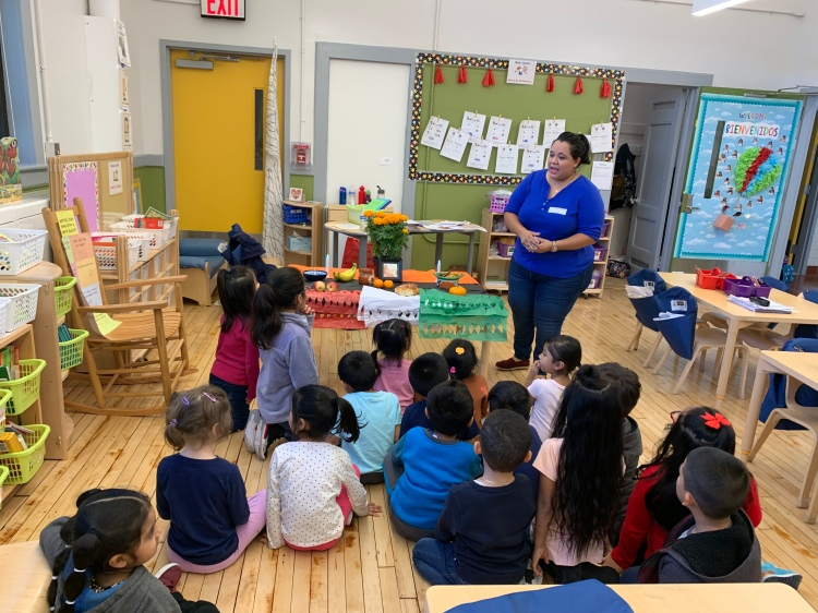 teacher teaching students about latinx history