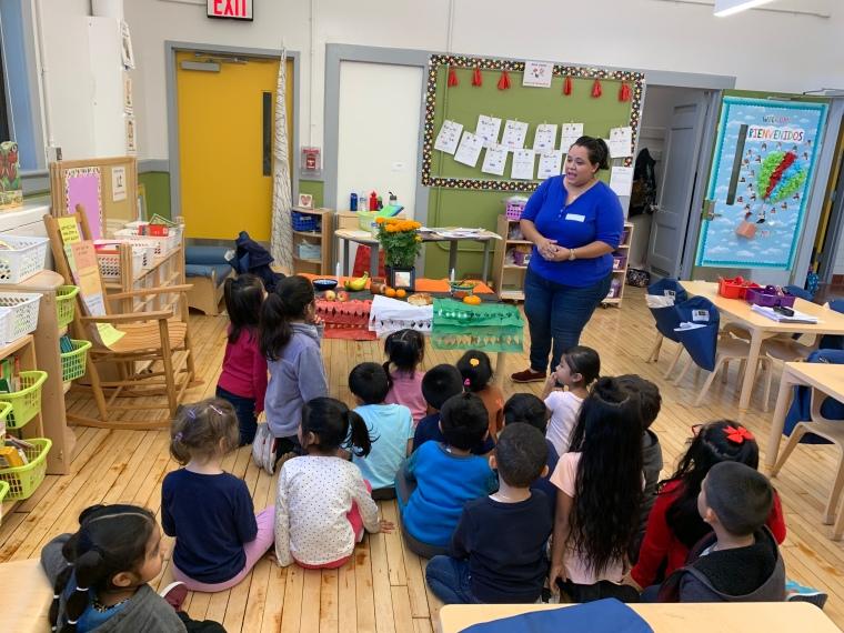 teacher teaching students about latinx history