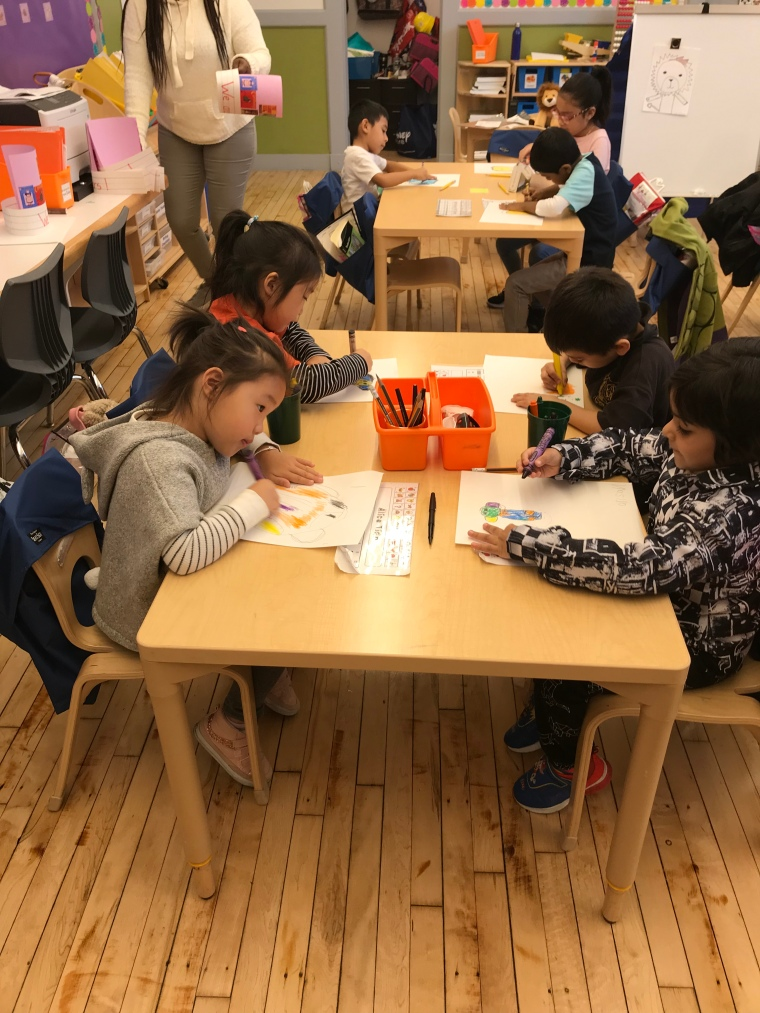 students drawing at a table
