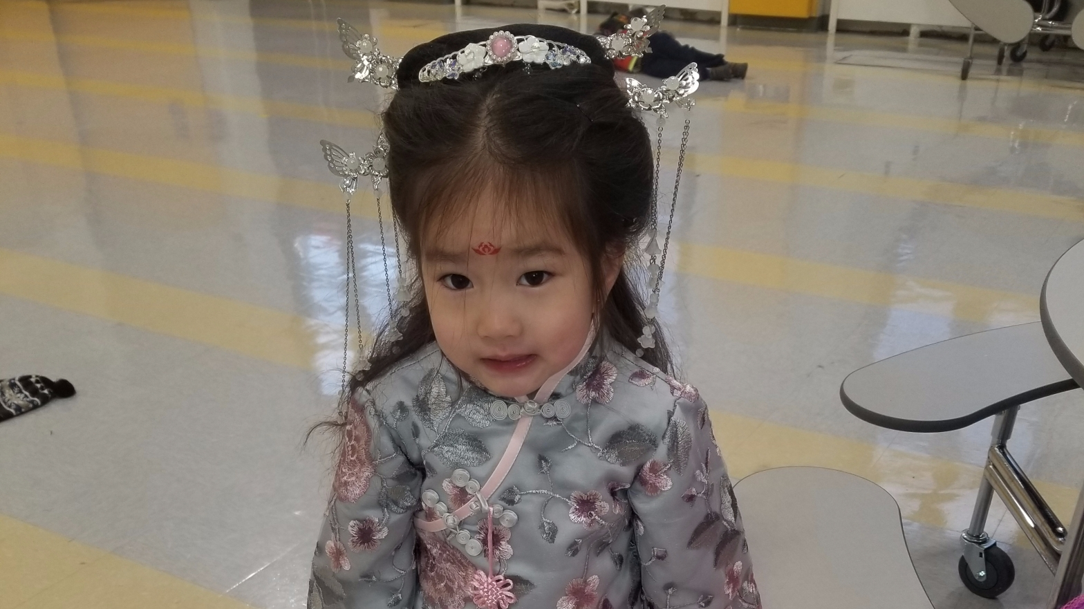 Student dressed for Lunar New Year.