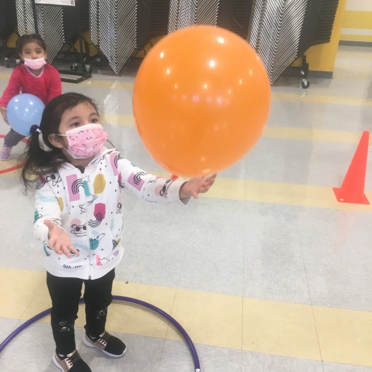 student with balloon