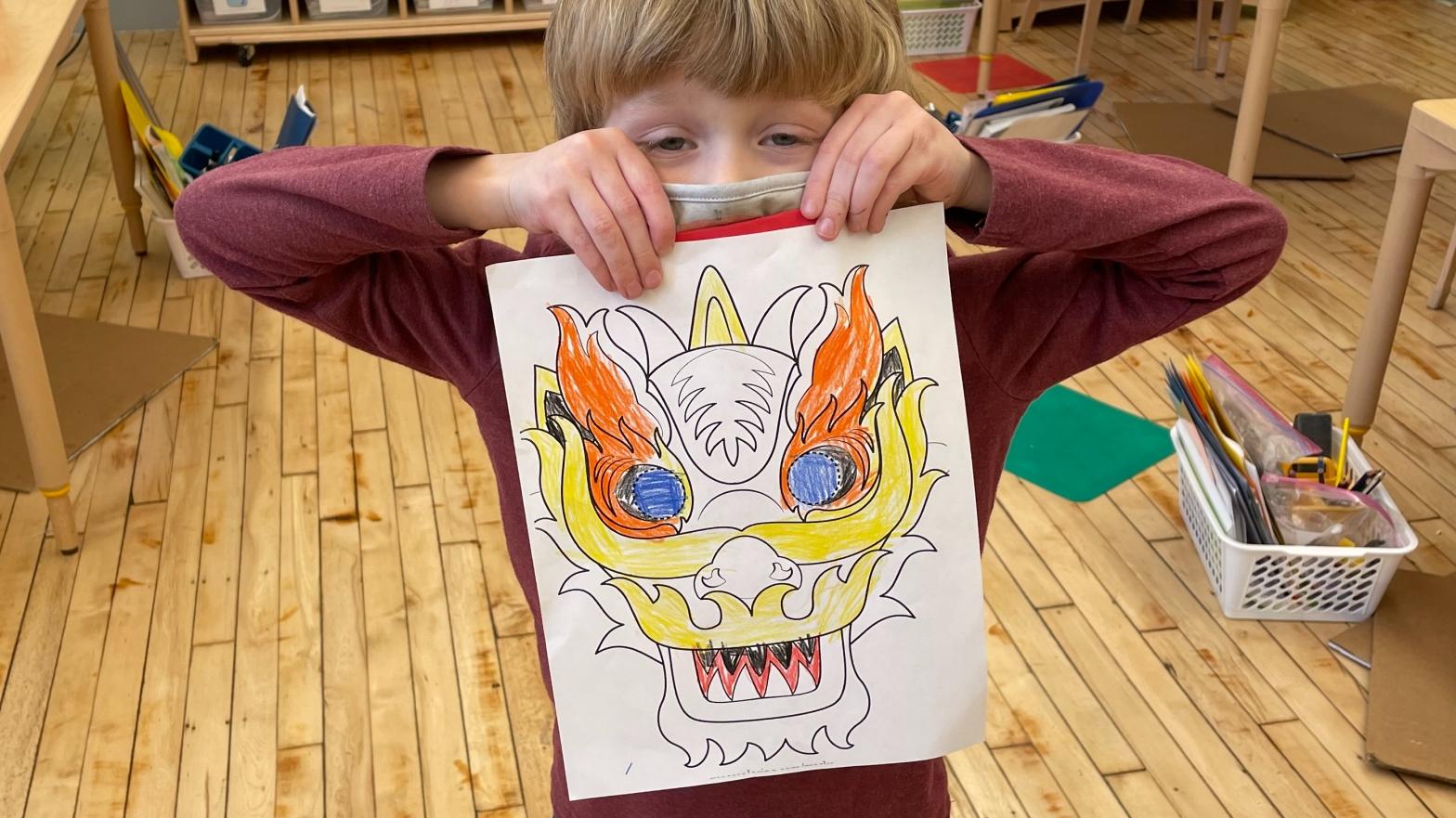 student holding lunar new year art