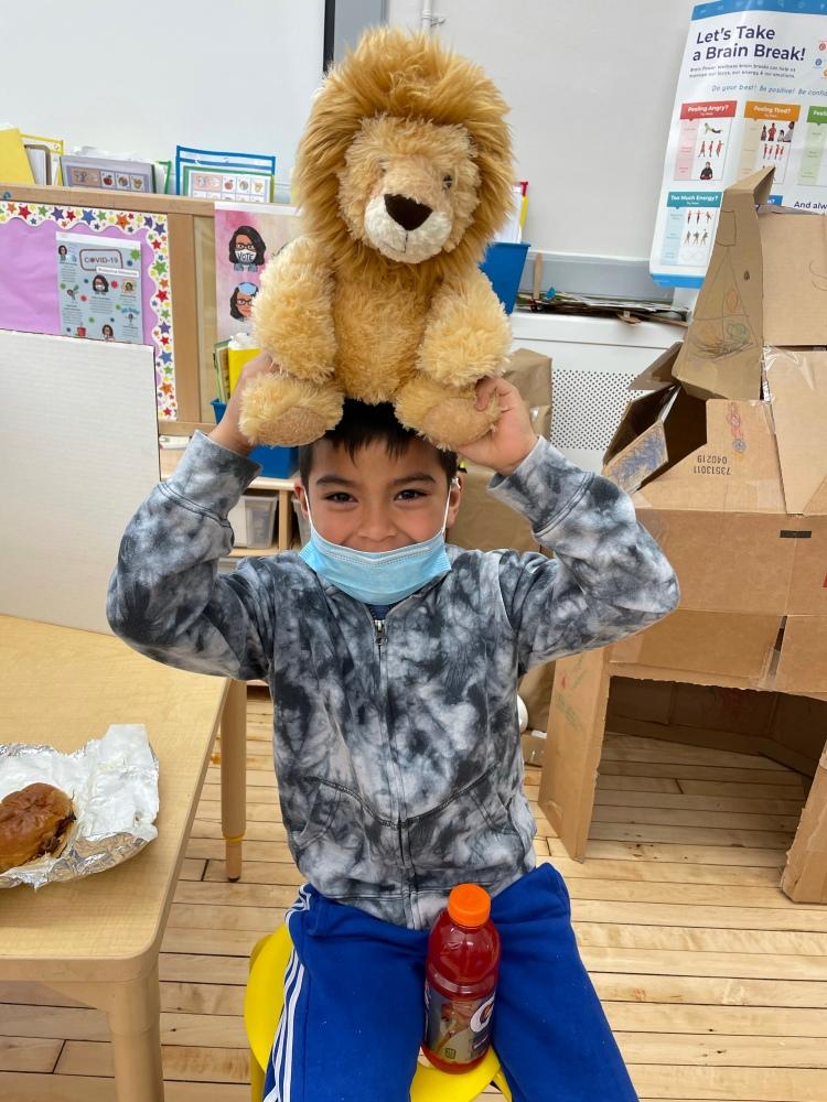 student with teddy bear