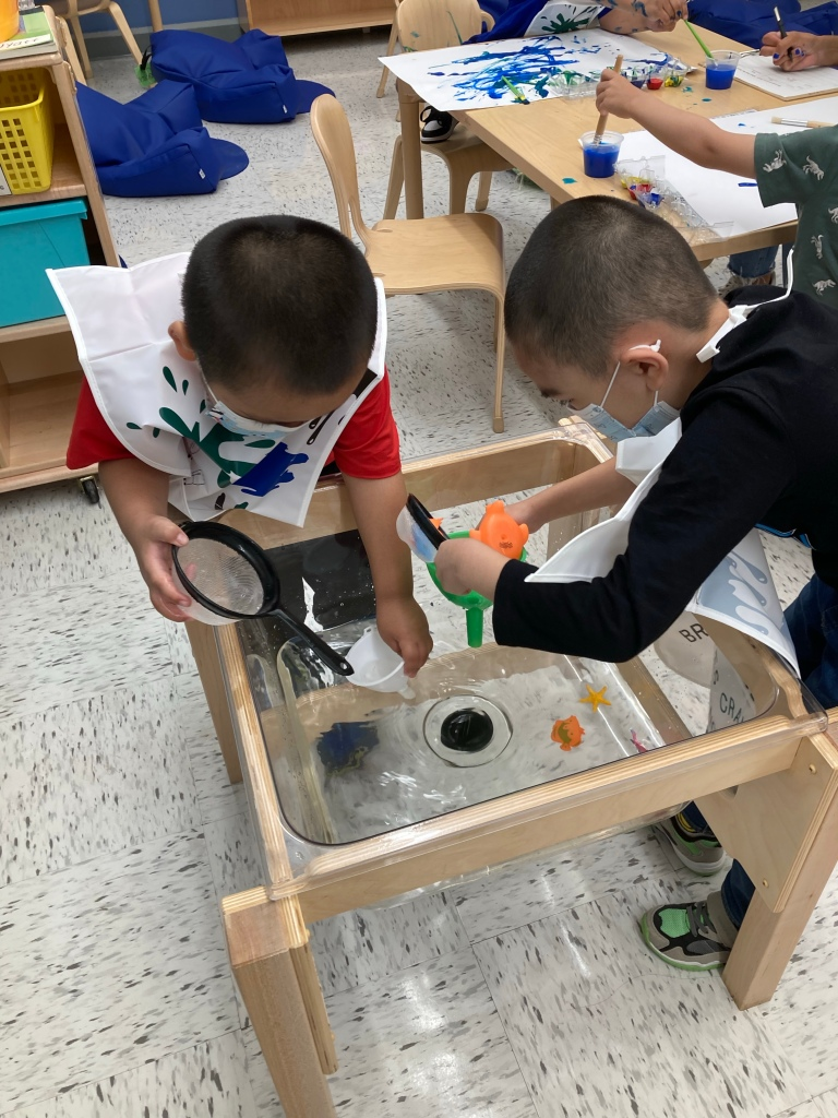 students exploring with water.