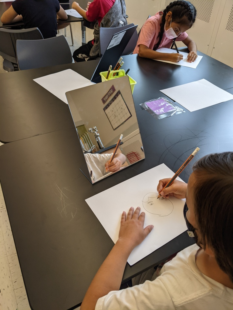 Students working on their self-portraits