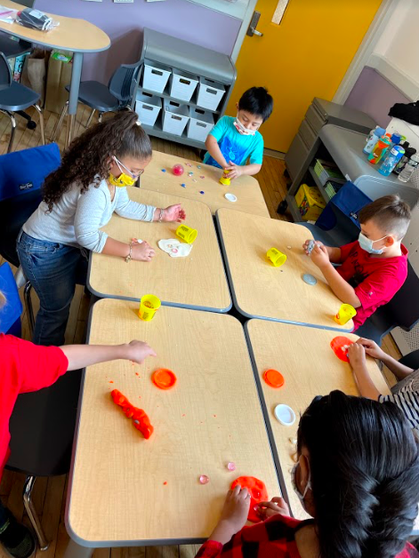 students working with playdoh